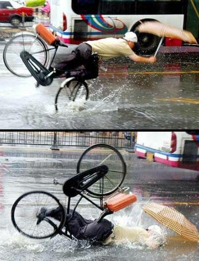 Ein Radfahrer legt sich im Regen auf die Schnauze.