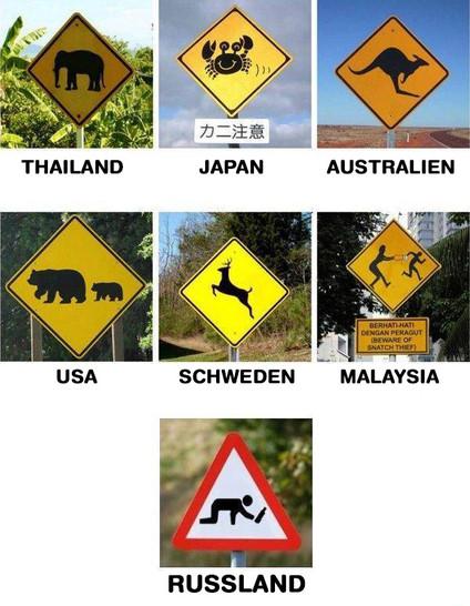 Eine Sammlung mit Warnschildern: Thailand (Elefanten), Japan (Krebse), Australien (Kängurus), USA (Bären), Schweden (Elche), Malaysia (Diebe) und Russland (Betrunkene).