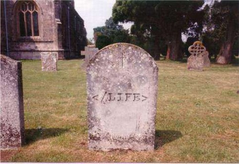 Ein Grabstein, auf dem ein </LIFE>-Tag zu lesen ist.